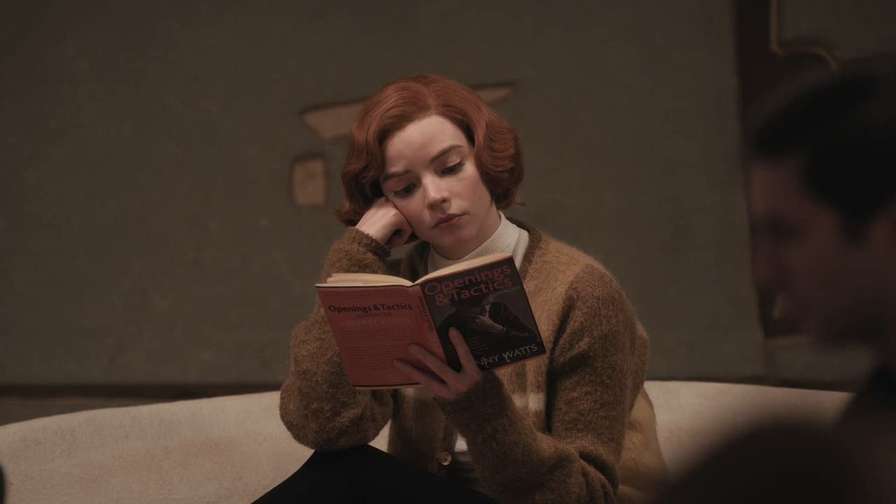 Anya Taylor Joy as Beth Harmon reading in The Queen's Gambit on Netflix