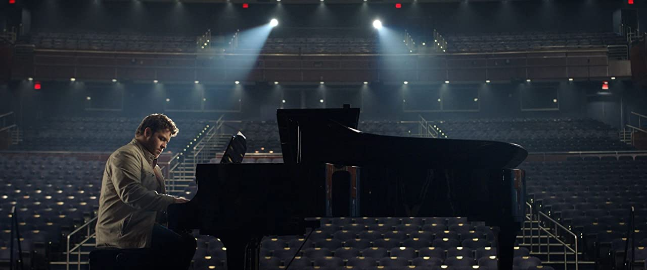 J. Michael Finley as Bart Millard of MercyMe in I Can Only Imagine playing piano